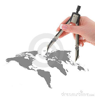 Hand with compasses on map