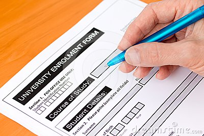 Hand Completing a University Application Form