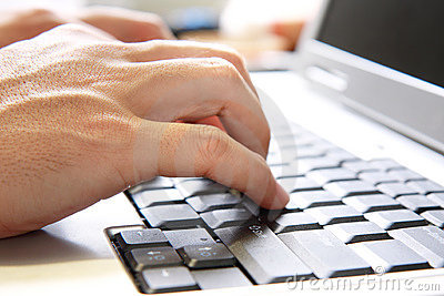 Hand On Computer Keyboard