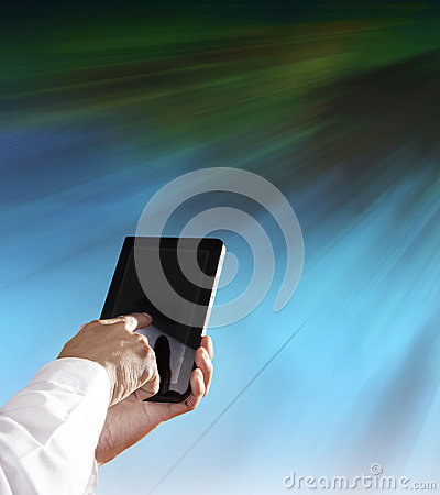 Hand and computer tablet with modern office building background
