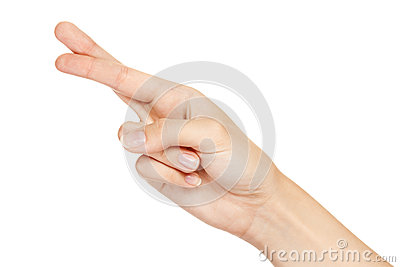 Hand with crossed fingers isolated