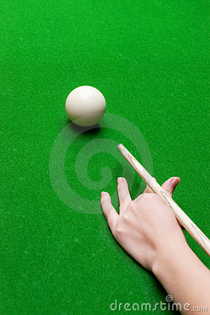 Hand with cue ready to hit