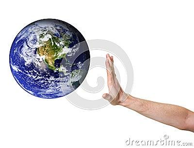 Hand denying entrance for planet earth