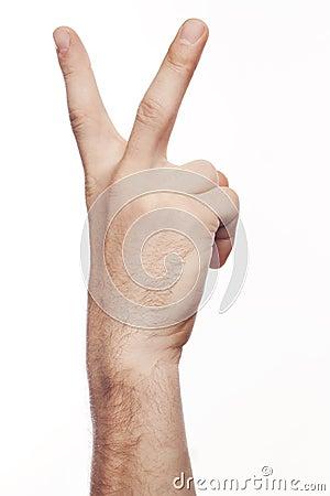Hand die het teken van overwinning en vrede toont