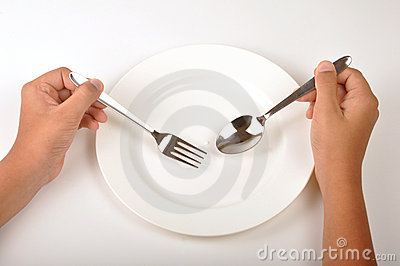Hand with dinner plate