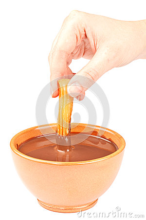 Hand Dipping a Churro in Chocolate
