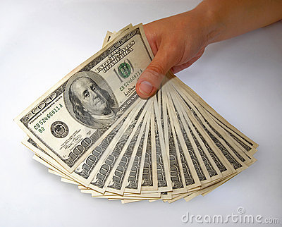Hand displaying a bundle of dollar bills