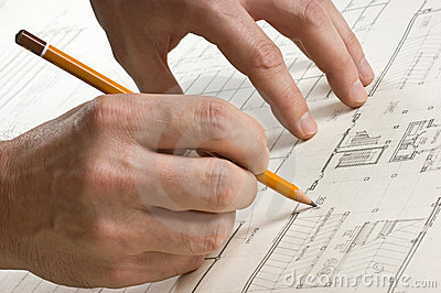 Hand draws a pencil on drawing