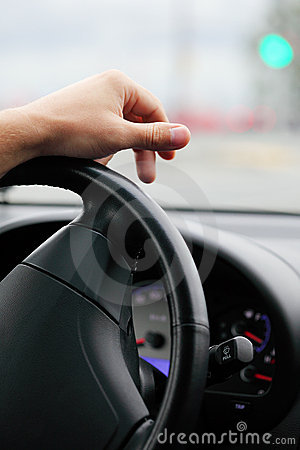 Hand of the driver on a steering wheel