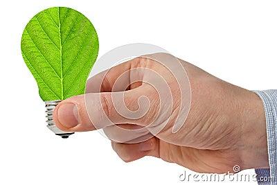 Hand with eco green energy light bulb