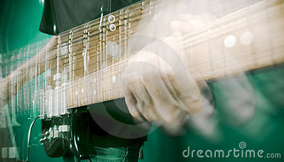 Hand and electric guitar