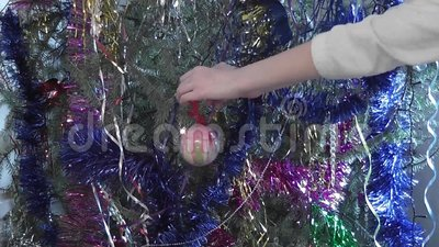 Hand girl touch christmas ball. Decoration christmas tree stock video footage