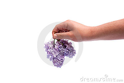 Hand giving flowers