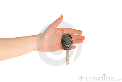 Hand giving a key isolated on white