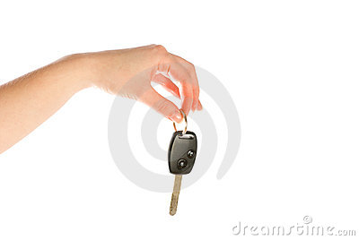 Hand giving key isolated on white