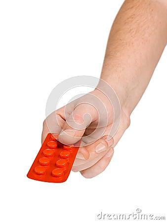 Hand giving pills