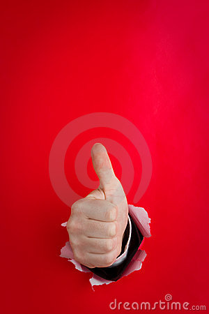 Hand giving thumbs up on red