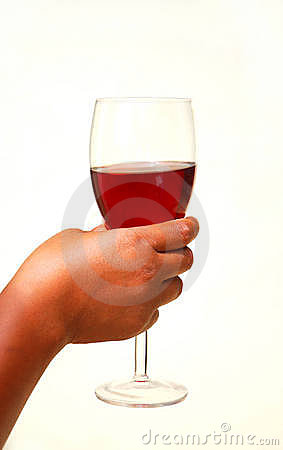 Hand with glass of red wine
