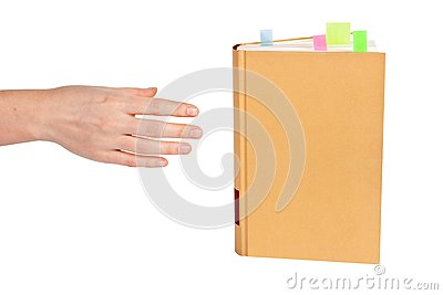 Hand goes to the book