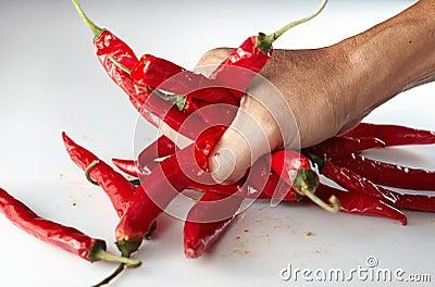 Hand grabing chili