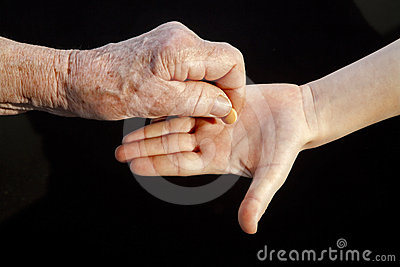 Hand of grandmother an grandchild and pill