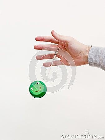 Hand with a green yo-yo