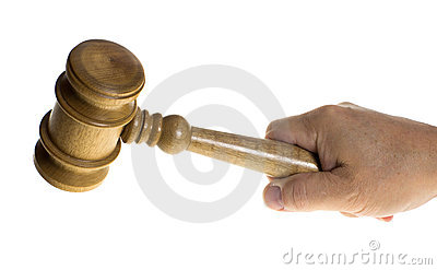 Hand gripping a wooden gavel