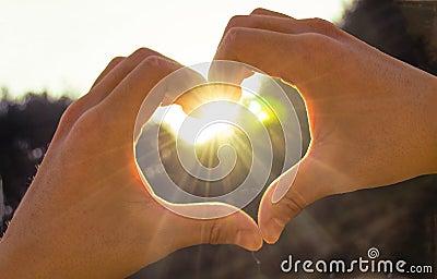 Hands heart sunshine Stock Photo