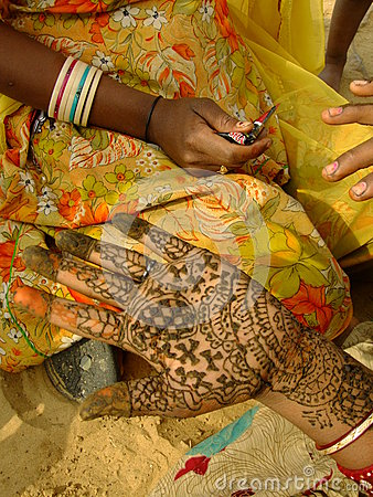 Hand with henna painting, India