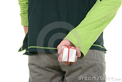 Hand hides small gift behind back