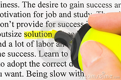Hand with highlighter and word solution