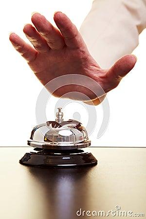 Hand hitting hotel bell