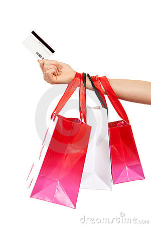 Hand hold credit gift card and shopping