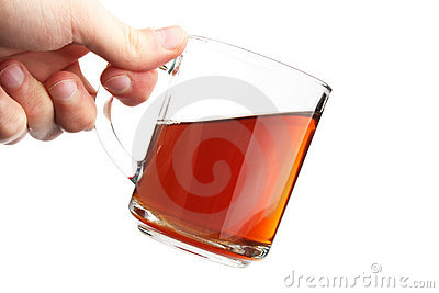 The hand hold a glass with is tea
