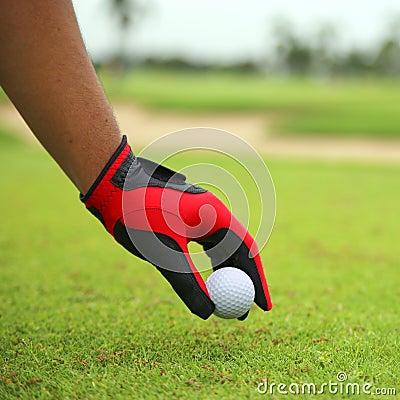 Hand hold golf ball