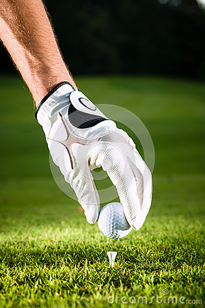 Free Hand Hold Golf Ball With Tee On Course Stock Photos - 26166773