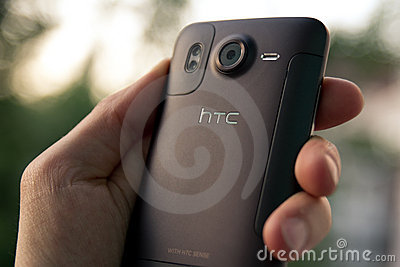 Hand hold HTC Desire HD smartphone Editorial Photography