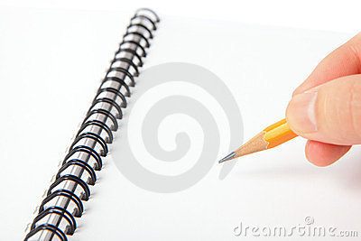 Hand hold a pencil writing on notebook