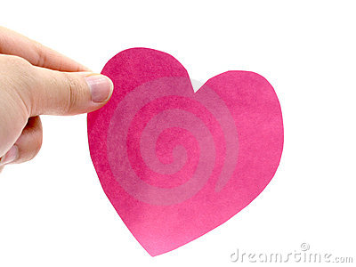 A hand hold a pink heart