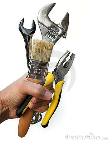 Free Hand Holding A Selection Of Tools Royalty Free Stock Photos - 6410928