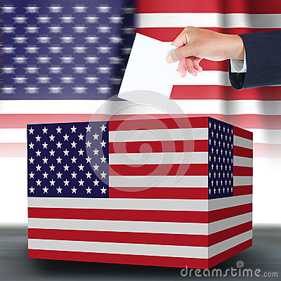 Hand holding ballot and box