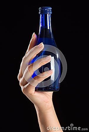 Free Hand Holding Blue Bottle Stock Images - 4959274