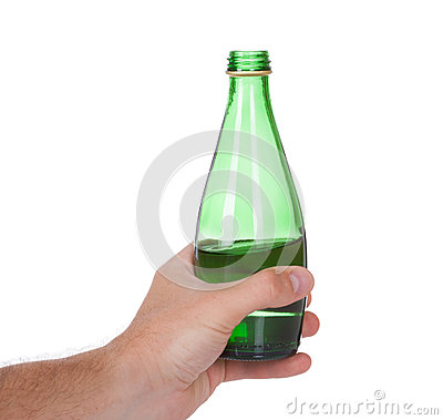 Hand holding a bottle of soda water