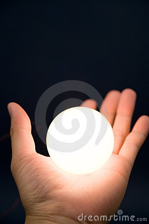 Hand holding a bright ball