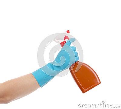 Hand holding brown plastic spray bottle