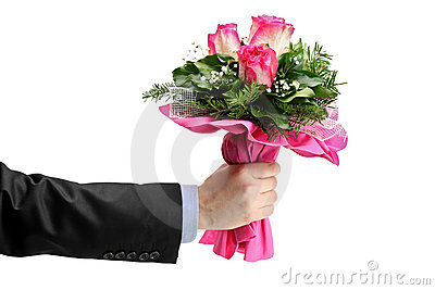 Hand holding bunch of roses
