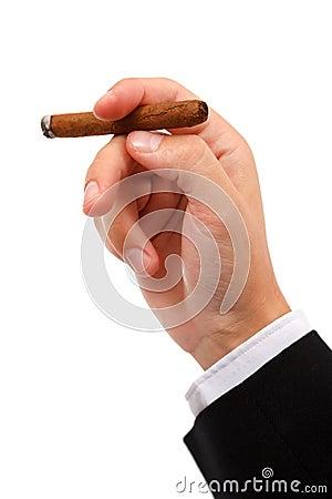Hand holding burning cigar