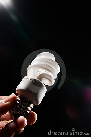 Hand holding cfl light-bulb lamp