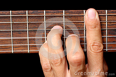 Hand holding a chord, and vibrating strings