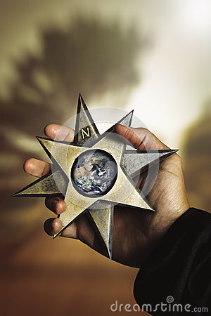 Free Hand Holding Compass Star Wind Rose With Earth Stock Photography - 58735122